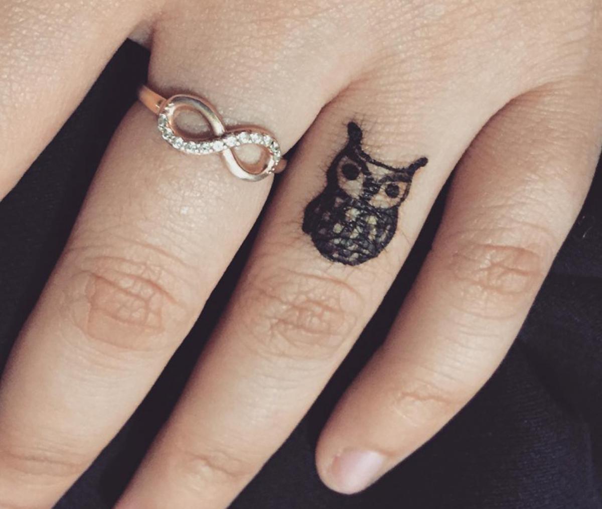 Small-Owl-Tattoo-on-Finger-designtrends.com